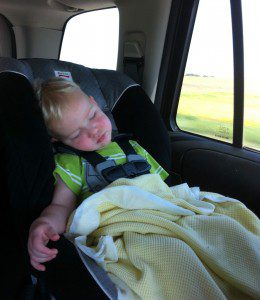 boy sleeping in carseat