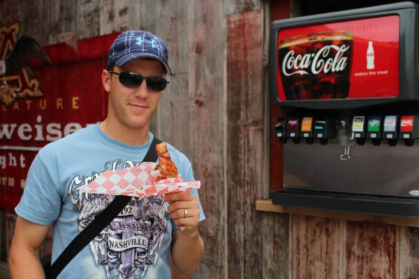 """Travis """"learning"""" about a Bacon-Wrapped Rib on a Stick"""