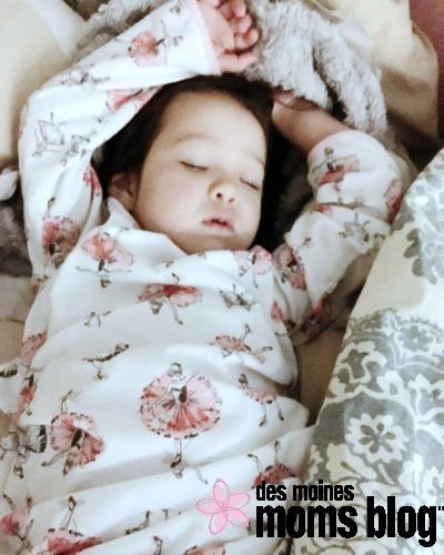 kid sleeping in parent's bed