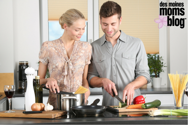 couple making dinner together at home date night idea