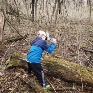 Boy chopping log