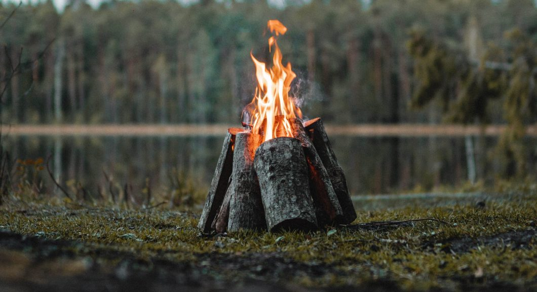 Fire on edge of lake